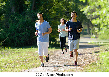 young people jogging in the park