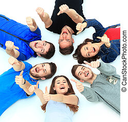 Young people lying down, gesturing thumb up sign
