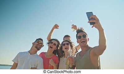 Young People Making a Selfie on the Beach