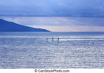 Young people Paddling Together in the sea