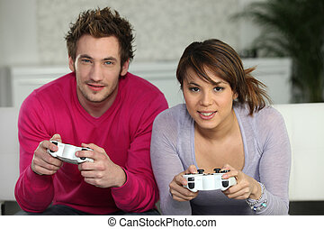 Young people playing computer games