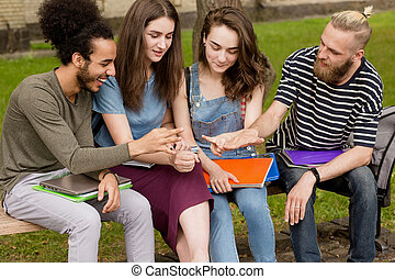 Young people playing student game rock paper scissors.