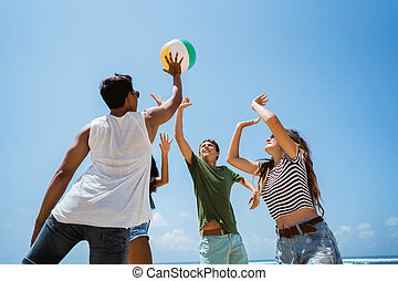 young people playing with volley ball