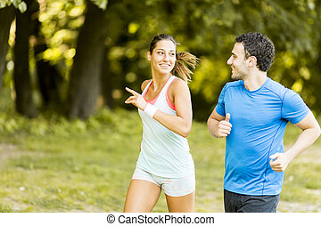Young people running - Photo of happy couple running in the...
