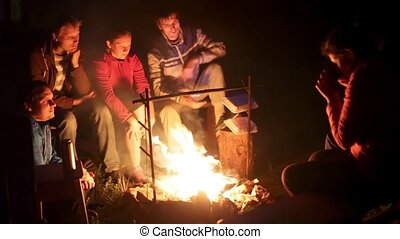 Young people sitting fire camp. Camping silence calm summer...