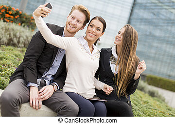 Young people taking photo with mobile phone