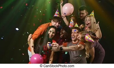 Young people taking selfie : happy friends posing for the camera. Slow motion