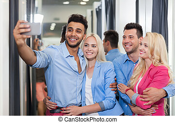 Young People Taking Selfie Photo Fitting Room Fashion Shop, Happy Smiling Couples Customers