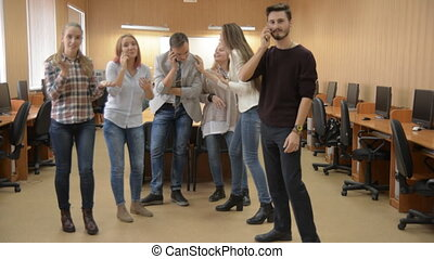 Young people talk on mobile phones and dance. The concept of...