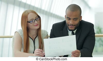 Young people talking in office - Smiling businessman in a...