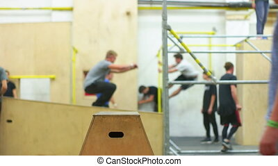 Young People Training in the Parkour Arena - Many youngers...