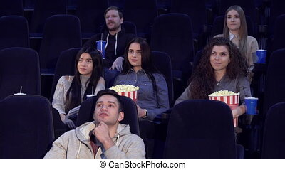 Young people watch film at the movie theater - Young people ...