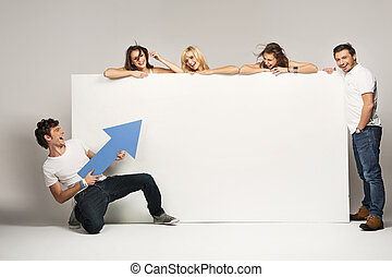 Young people with an empty board