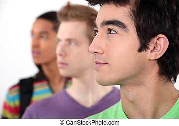 Young people with their eyes fixed on an object