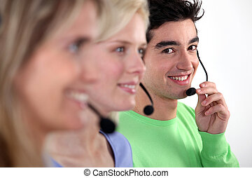 Young people working in a call centre