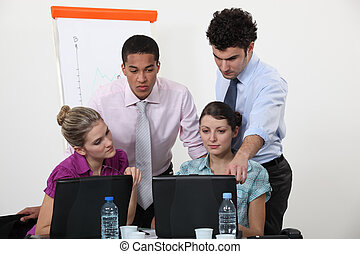 Young people working on a business presentation