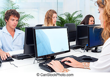 Young people working together in office.