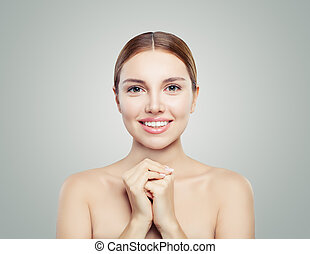 Young perfect female face. Perfect girl with healthy skin. Facial treatment, skincare and cosmetology concept.