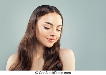 Young perfect model woman with healthy skin and long brown hair portrait. Natural beauty