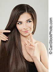 Young Perfect Model Woman with Long Smooth Shiny Hair Studio Portrait