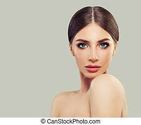 Young perfect woman portrait. Beautiful female face. Cosmetology, beauty and skincare concept