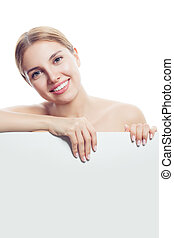 Young perfect woman with healthy skin smiling on white background with copy space