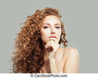 Young perfect woman with long healthy curly hair