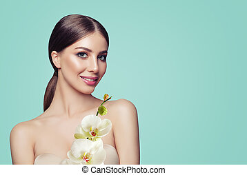 Young Perfect Woman with Makeup and Orchid Flowers on Pastel Blue Background, Beauty Portrait