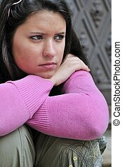 Young person in depression outdoors - Portrait of young...