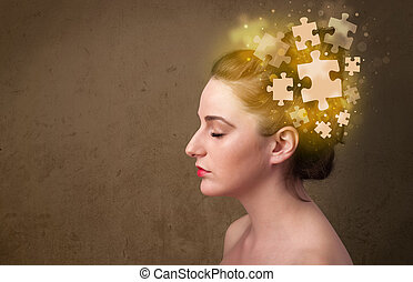 Young person thinking with glowing puzzle mind on grungy ...