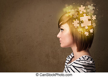 Young person thinking with glowing puzzle mind on grungy...