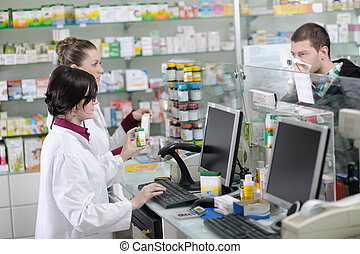 pharmacist suggesting medical drug to buyer in pharmacy...