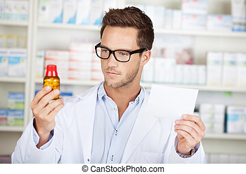 Young Pharmacist With Prescription At Drugstore - Young male...