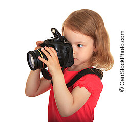 Young photographer.  - A little girl with a big camera.