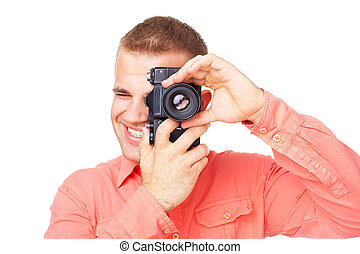 Young photographer taking pictures with his camera isolated ...