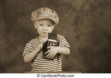 Young photographer - Young blond boy holding retro twin-lens...