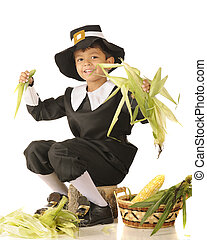 Young Pilgrim Husker - A young Pilgrim boy happily husking...