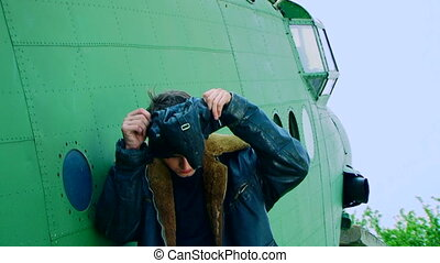 Young pilot in front of a plane