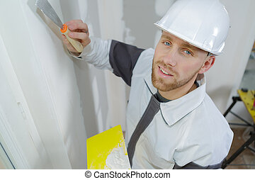 young plasterer at work