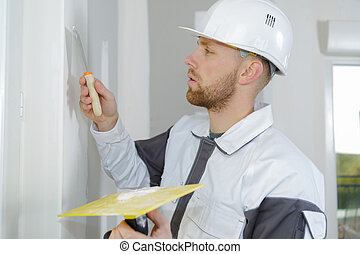 young plasterer using a spatula