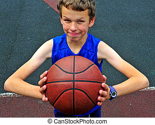 Young player with a basketball on the court