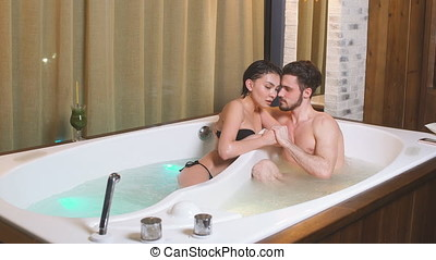 Young pleasant multi racial lovers in bathtub. - Young...