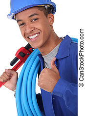 Young plumber with a wrench