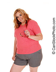 Young plus size woman standing in shorts.