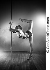 Young pole dance woman. Black and white.