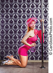 Young pole dance woman. Bright colors