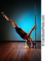 Young pole dance woman stretching.