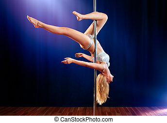Young pole dance woman upside down.