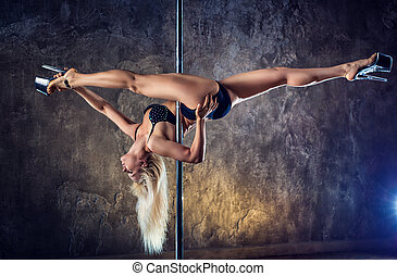 Young pole dance woman - Young blond sexy pole dance woman...