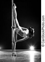 Young pole dance woman - Young slim pole dance woman. Black...